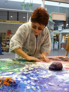 Silja working on a big painting