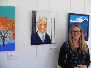 Helen beside her artwork