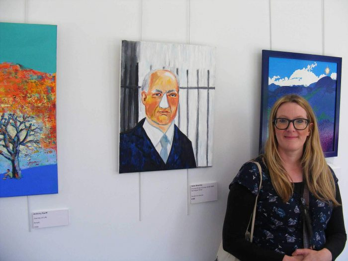 Helen beside her artwork